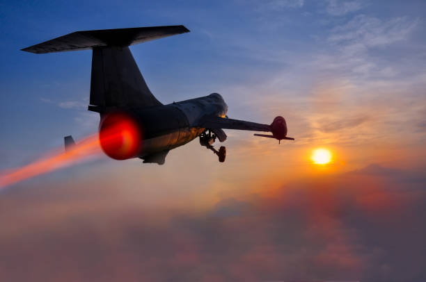 Night flight. Military Airplane in the sky at sunset Night flight. Military Airplane in the sky at sunset supersonic airplane stock pictures, royalty-free photos & images