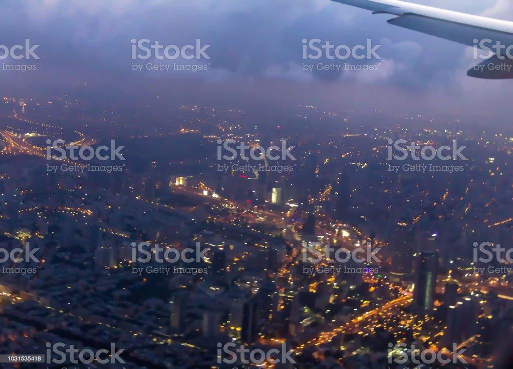 Night flight over Tel Aviv during landing at the  Ben Gurion International Airport stock photo