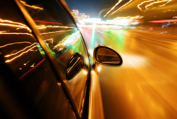 night, high-speed car - rideshare stock photos and pictures