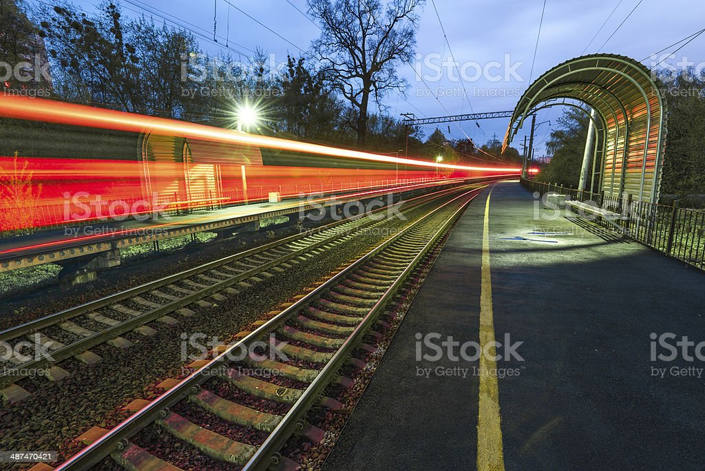 Night high-speed train in motion blur showing light trails stock photo