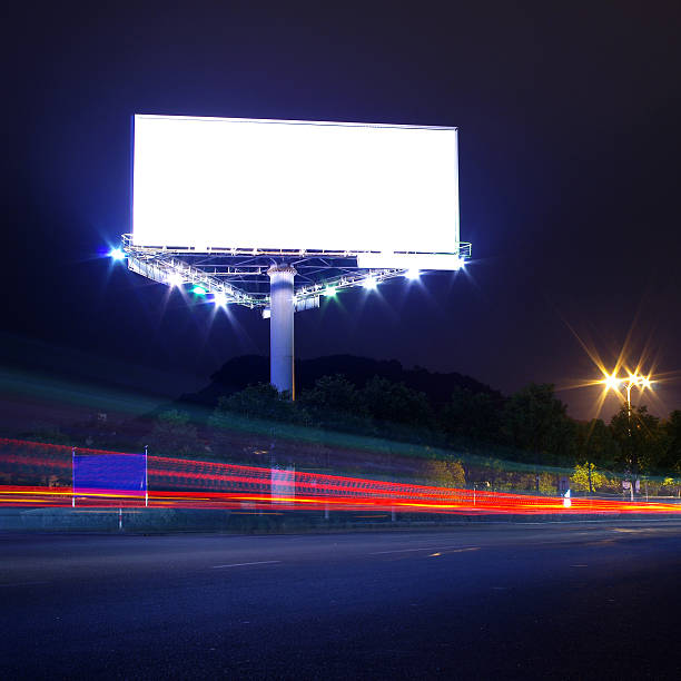 Night highway billboard Cars and billboards electronic billboard stock pictures, royalty-free photos & images
