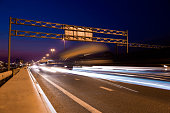 Light trails at night on the M5 highway near Moscow in Russia