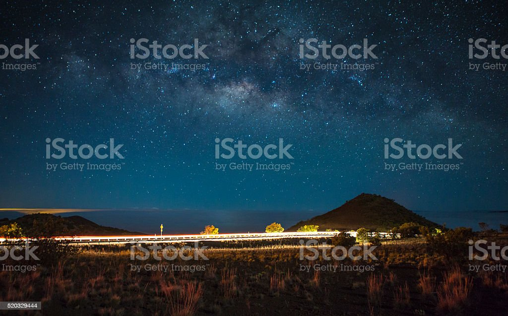 Night Highway Scene Above the Clouds in Hawaii stock photo