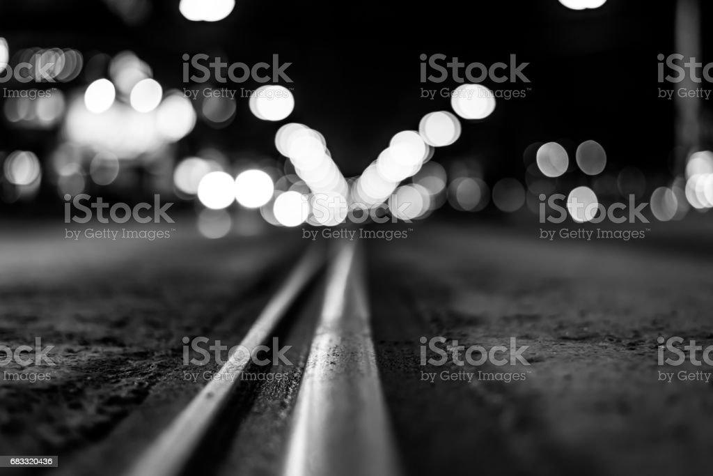 Night highway with rails, cars go over it foto de stock libre de derechos