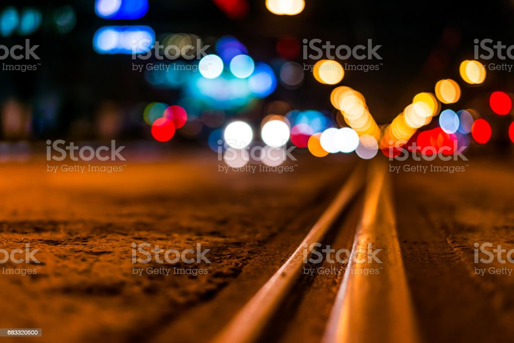 Night highway with rails, cars go over it foto stock royalty-free
