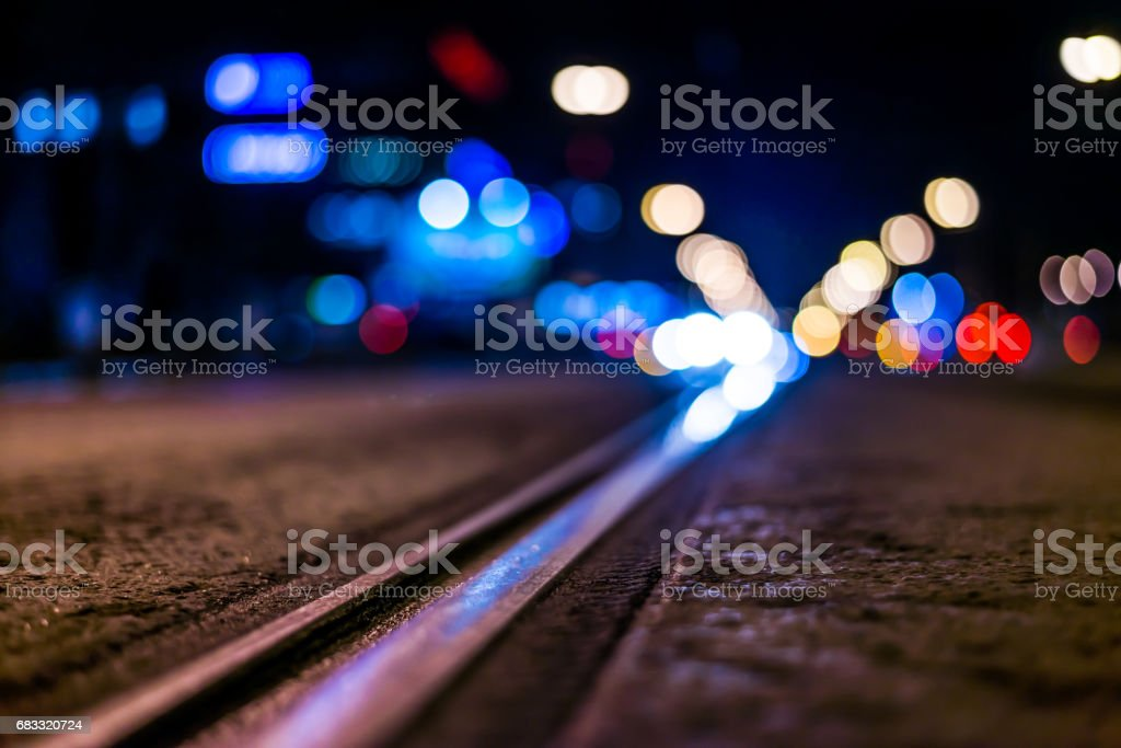 Night highway with rails, cars go over it royalty-free stock photo