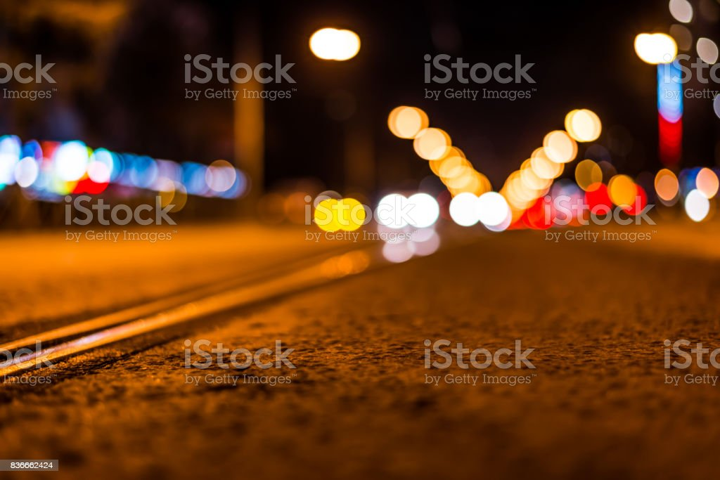 Night highway with rails, cars go over it stock photo
