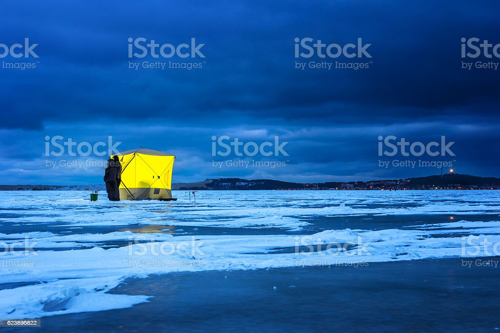 Night ice fishing. stock photo