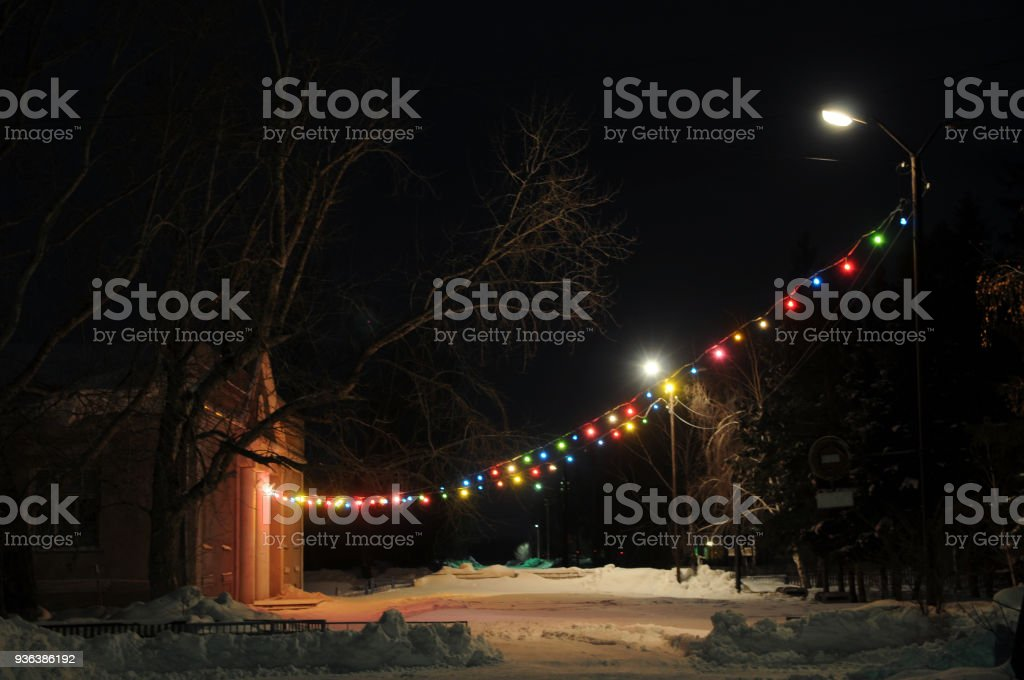 Night illuminating colorful decorative lamps suspended outdoor stock photo