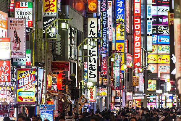 night illumination a lot of advertising and crowd of people - shinjuku ward stock photos and pictures
