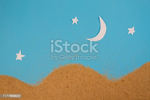 Night in desert. Paper art of moon and sand