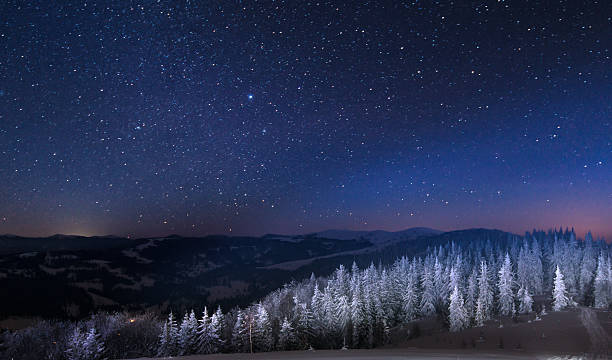 night in the snowy mountains - night stock photos and pictures