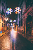 Wet city streets, christmas decorations.