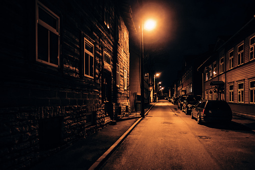 Dark street in old residential district - Kalamaja. Tallinn, Estonia