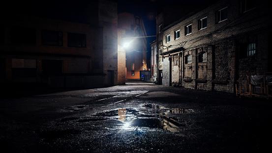 Dark street in old industrial district - Telliskivi. Tallinn, Estonia