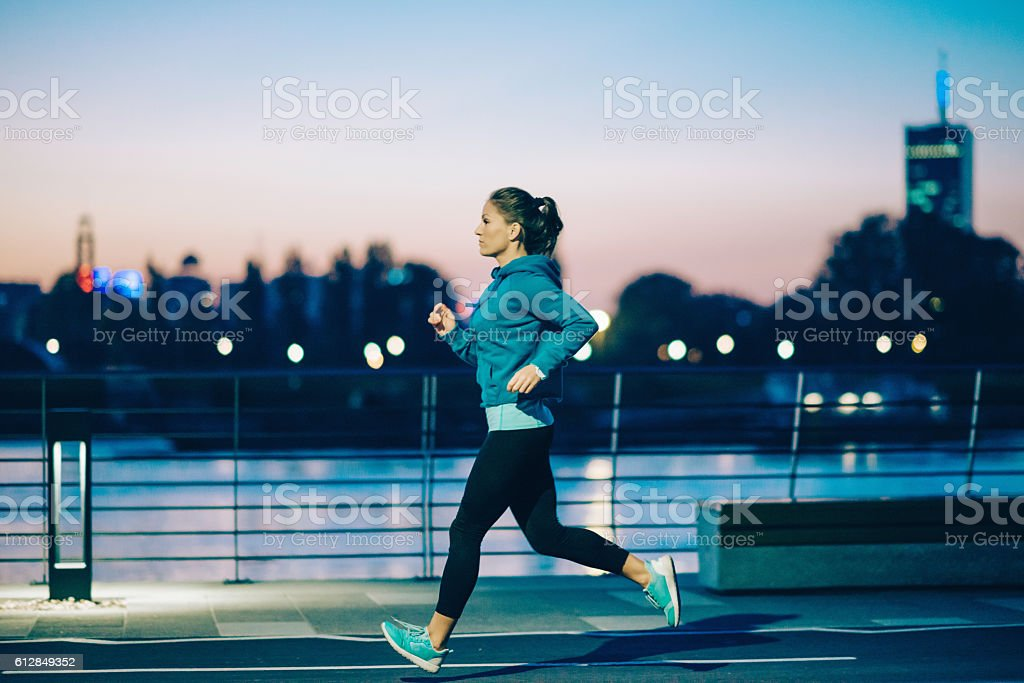 Night jogging in the city stock photo