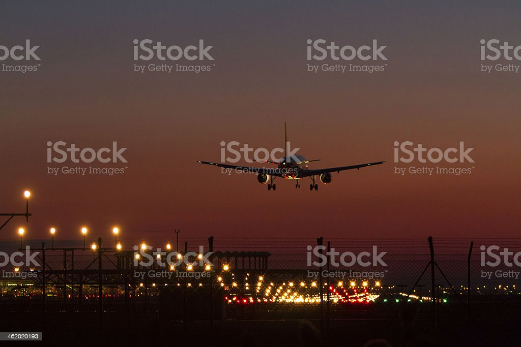 Night landing at an airport royalty-free stock photo