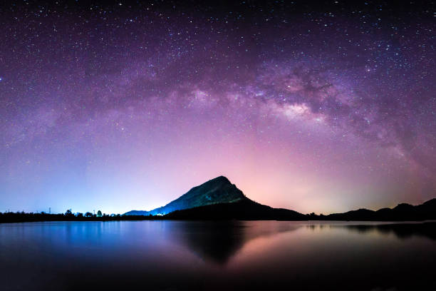 night landscape mountain and milkyway  galaxy background , thailand , long exposure ,low light stock photo