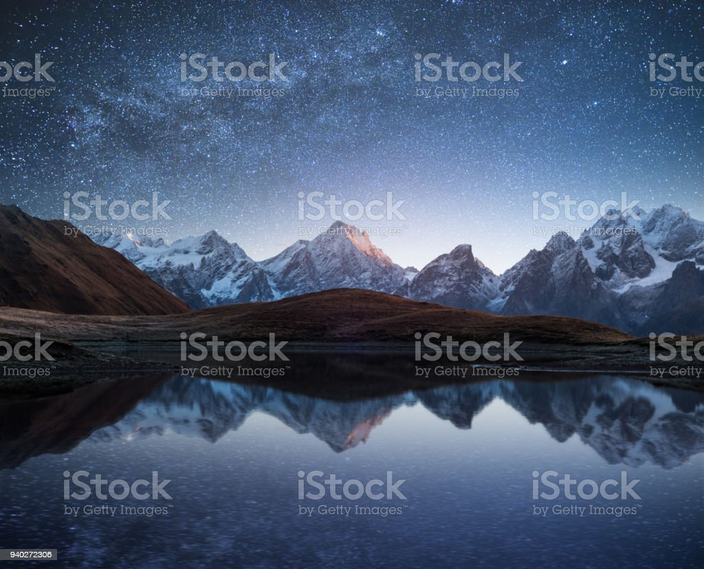 Night sky with stars and the Milky Way over a mountain lake. Collage...