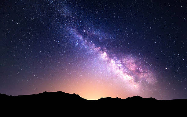 Night landscape with Milky Way. Starry sky, Universe Night landscape with colorful Milky Way and yellow light at mountains. Starry sky with rocks at summer. Beautiful Universe milky way stock pictures, royalty-free photos & images