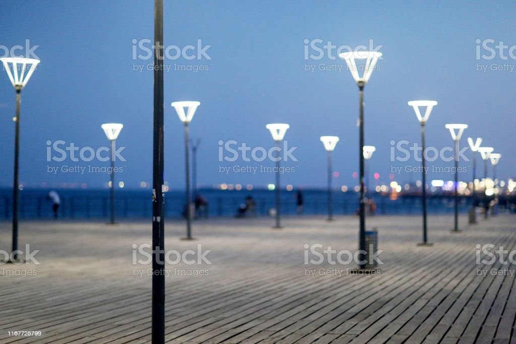 Night led street lights with energy-saving lamps for people.