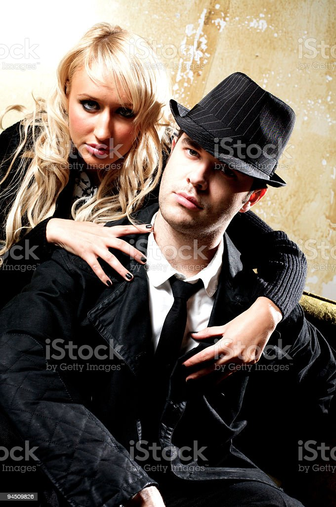 night life couple looking at the camera stock photo