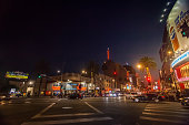 Los Angeles, USA -  Aug 13, 2018: Night life in the geart of Hollywood. Illuminated intrsection of Hollywwod Blvd and Highland Av.