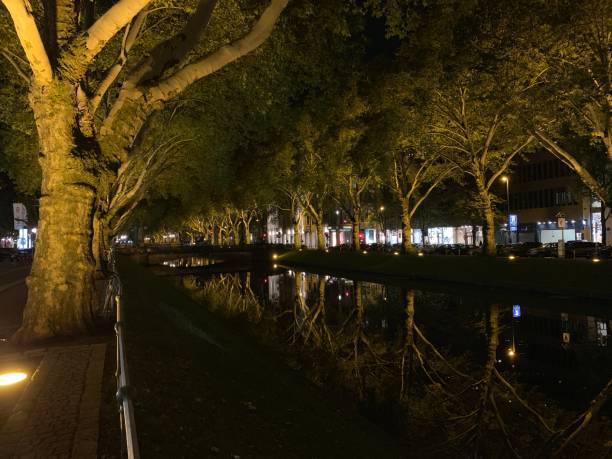 Night life reflections on a river stock photo