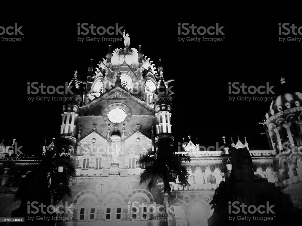 Night Light View of Chhatrapati Shivaji Terminus Railway Station Black and White Night Light view of Chhatrapati Shivaji Terminus Railway Station of Mumbai, India, previously known as Victoria Terminus. The architecture design has influences from Victorian Italianate Gothic Revival architecture and traditional Mughal buildings.  Architecture Stock Photo