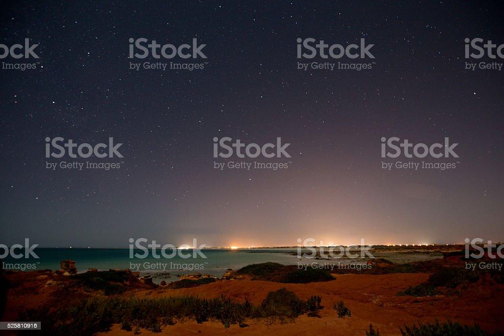 Night lights on the beach stock photo