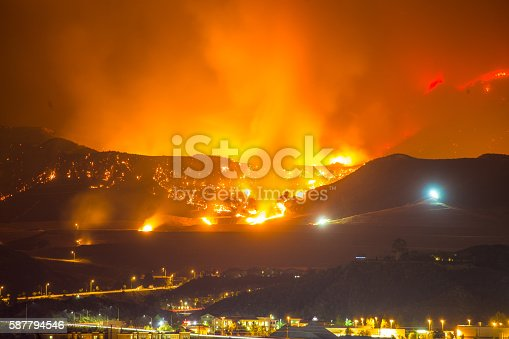 Night long exposure photograph of the Santa Clarita wildfire in CA. The Santa Clarita Valley mountains has drawn firefighters and emergency crews in the hills toward Acton. So far, the fire has burned 38,346 acres.