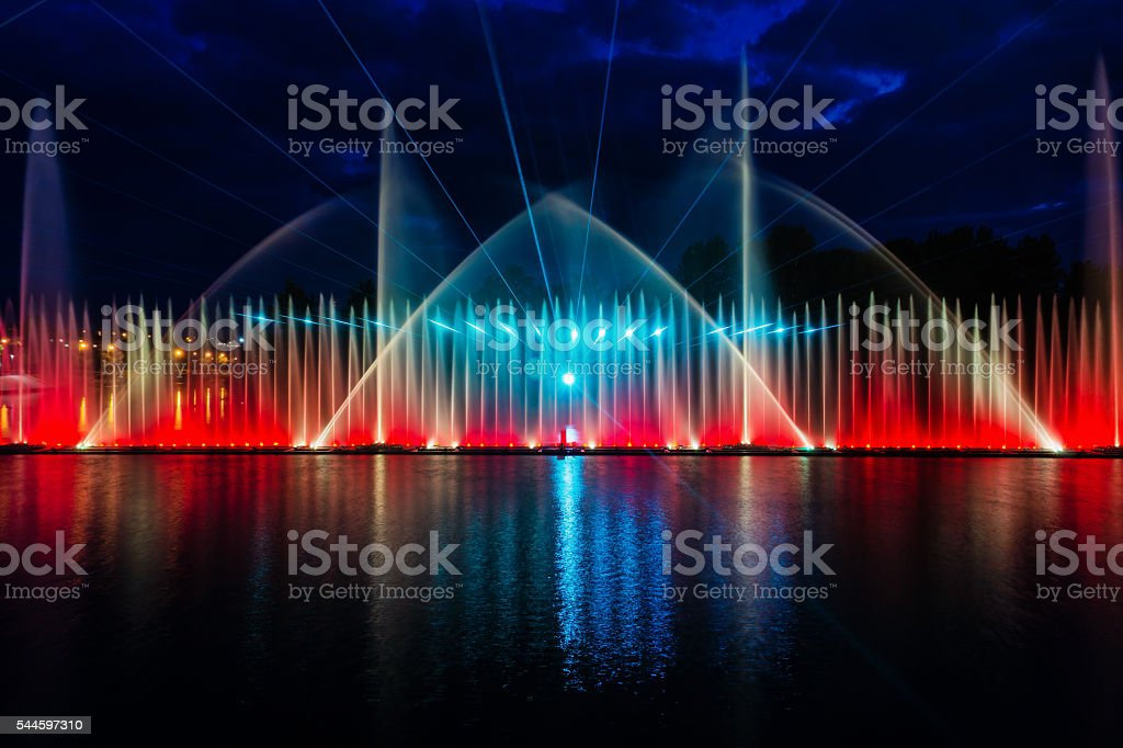 Night magic show of fountains on the central waterfront Roshen stock photo