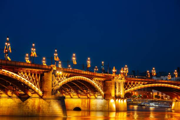 Night of Margaret Bridge with Danube river in Budapest, Hungary stock photo