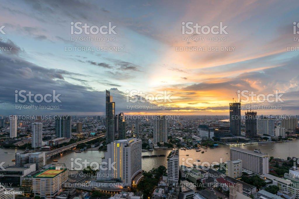 Night of the Metropolitan Beautiful sunset curve Chao Phraya River long exposure light Bangkok City downtown cityscape urban skyline  Thailand in 2017 - Cityscape Bangkok city Thailand stock photo