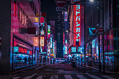 A night of the neon street at the downtown wide shot. Shinjuku district Tokyo / Japan - 08.29.2019 It is a famous town in Shinjuku. It's called SHIBUYA crossing. We can see many people & neon billboard.