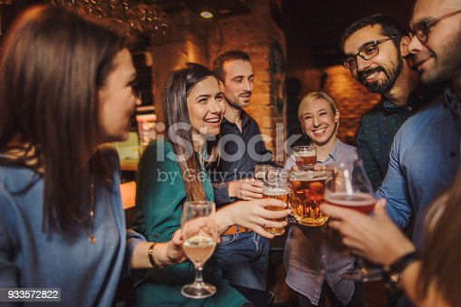 933516938 istock photo Night out with friends 933572822