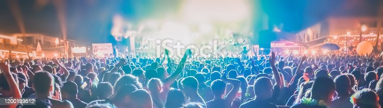 Many people enjoy outdoor music festivals in the night