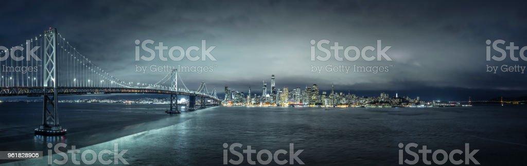 Night panorama of San Francisco skyline with Bay Bridge. stock photo