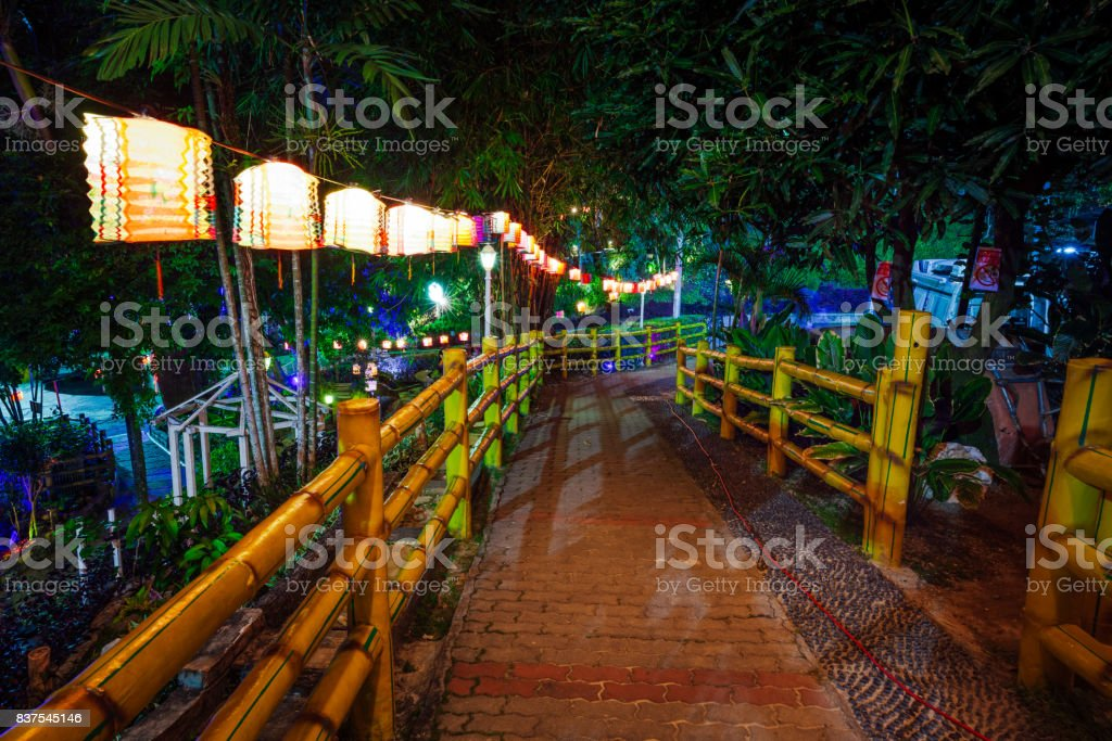 Night park decorated with paper lanterns stock photo