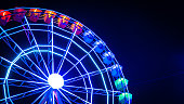 istock Night photo of a moving illuminated Ferris wheel in Madrid, Spain 1174882798