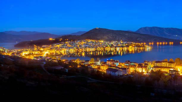 Night photo of Kastoria, with reflections in Orestiada Lake stock photo