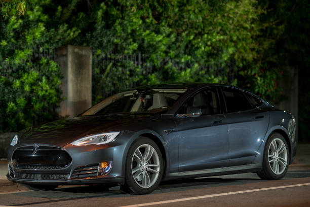 Night photo with light painting Tesla Model S Miami Beach, FL, USA - June 15, 2019: Night photo with light painting Tesla Model S tesla model s stock pictures, royalty-free photos & images