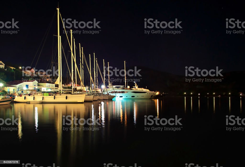night photography of sailboats at Ithaca island Greece - long exposure photography stock photo
