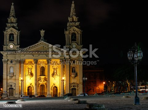 istock Night photography of the Saint Publius Parish Church also known as the Floriana Parish Church. 1020659076