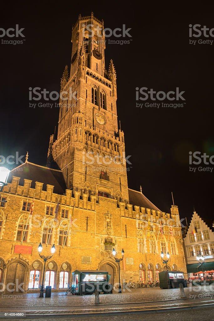 night picture of belfried tower in Brugge, Belgium stock photo