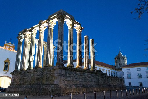 istock Night picture of the roman temple of Evora (Portugal). 842231780