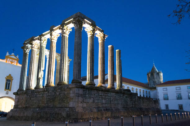 Night picture of the roman temple of Evora (Portugal). The Roman temple of Evora (Portugal) dates from the first century AD and is an UNESCO world heritage site iberian stock pictures, royalty-free photos & images