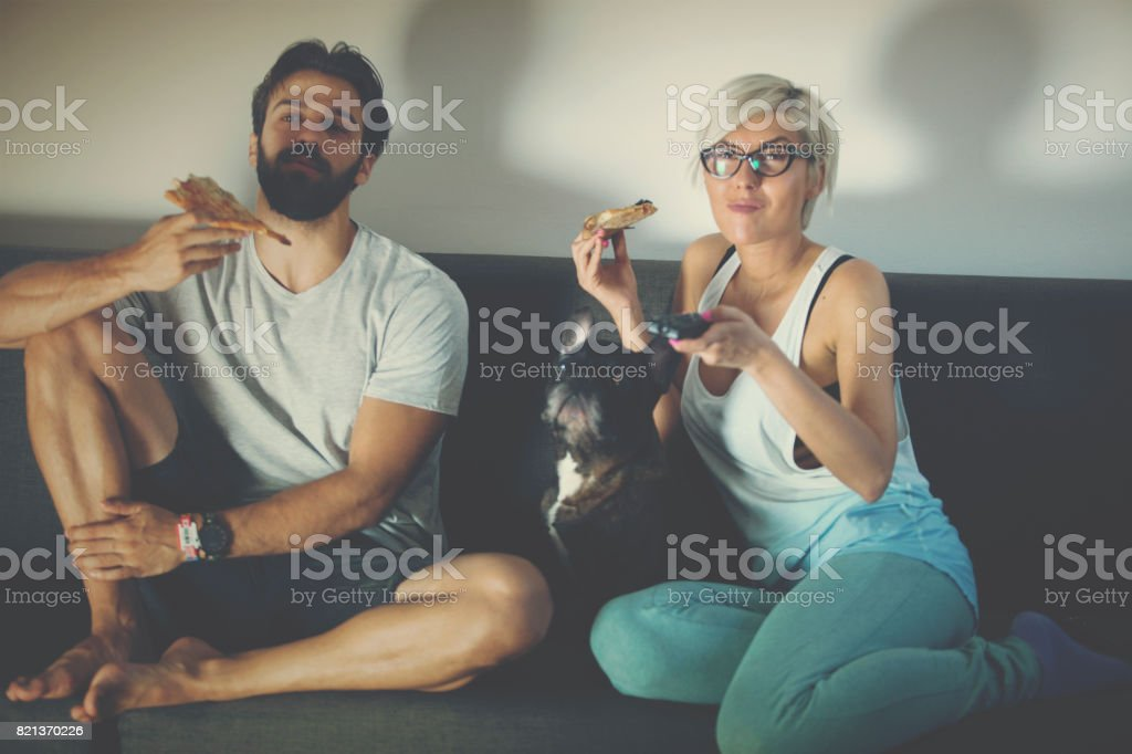 Night relaxation with dinner, TV and pet stock photo