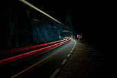 Long exposure image of a car entering the tunnel