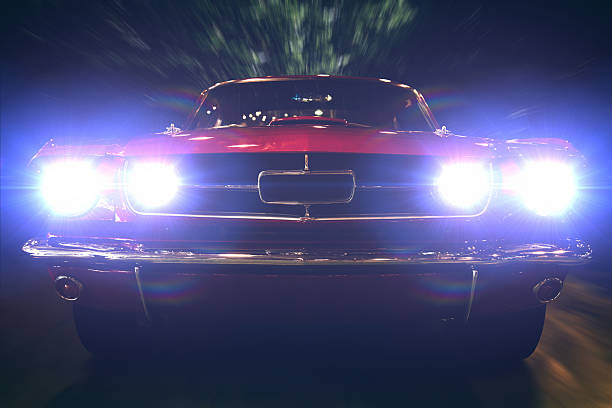 Night ride Close-up of retro car with bright headlights on. headlight stock pictures, royalty-free photos & images